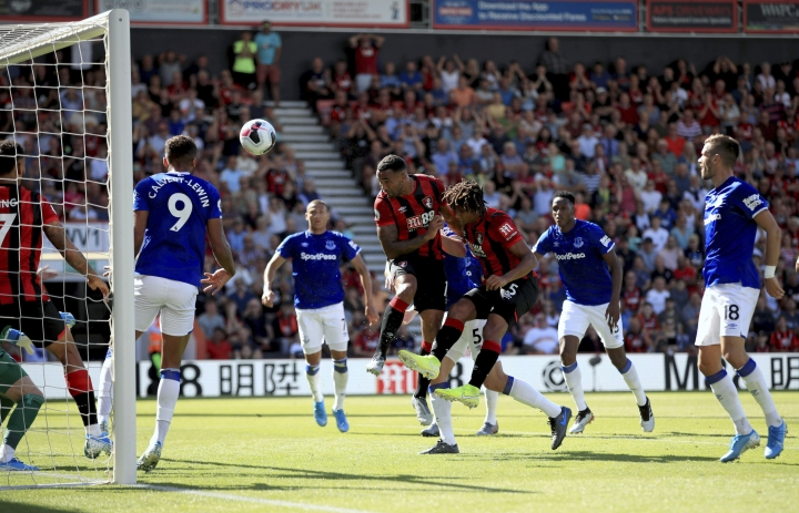 Bournemouth's Callum Wilson, center, scores his side's first goal of the game during the English Premier League soccer match between Bournemouth and Everton at The Vitality Stadium, Bournemouth, England, Sunday, Sept. 15, 2019. (Adam Davy/PA via AP)