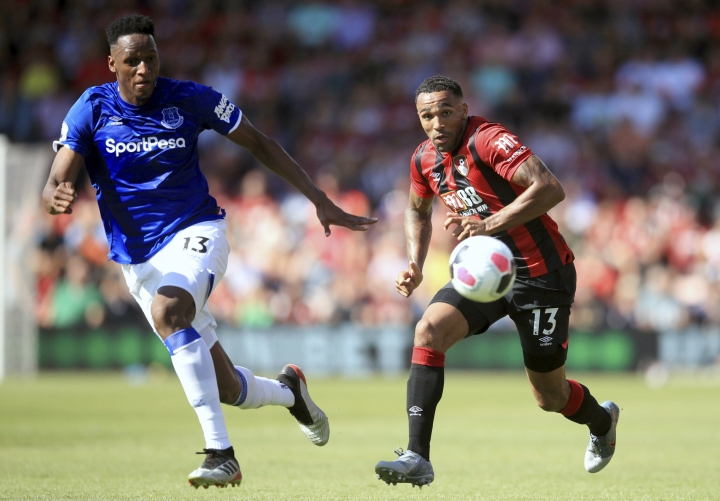 Everton's Yerry Mina, left, and Bournemouth's Callum Wilson battle for the ball during the English Premier League soccer match between Bournemouth and Everton at The Vitality Stadium, Bournemouth, England, Sunday, Sept. 15, 2019. (Adam Davy/PA via AP)