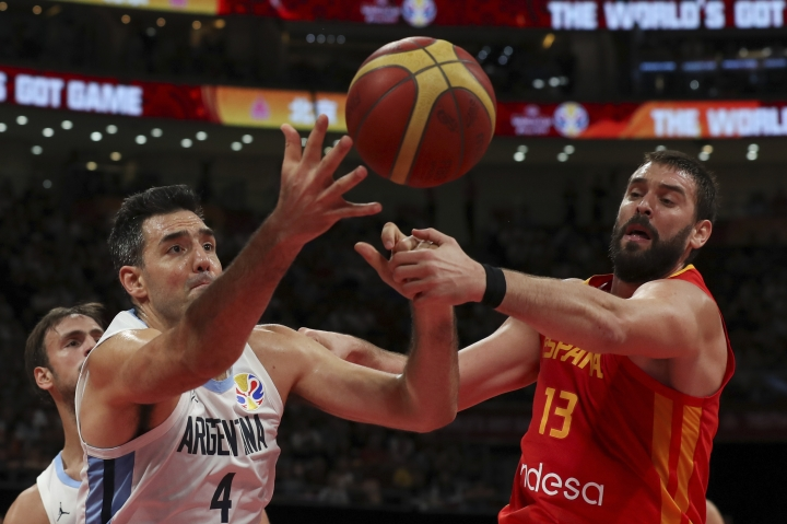 Luis Scola of Argentina and Marc Gasol of Spain battle the ball during their FIBA Basketball World Cup Final, at the Cadillac Arena in Beijing, Sunday, Sept. 15, 2019. (AP Photo/Ng Han Guan)