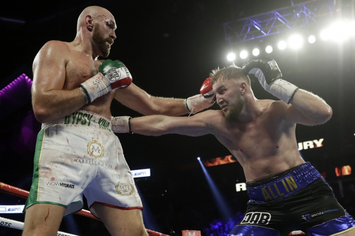 Otto Wallin, right, of Sweden, tries to hit Tyson Fury, of England, with a right during their heavyweight boxing match Saturday, Sept. 14, 2019, in Las Vegas. (AP Photo/Isaac Brekken)