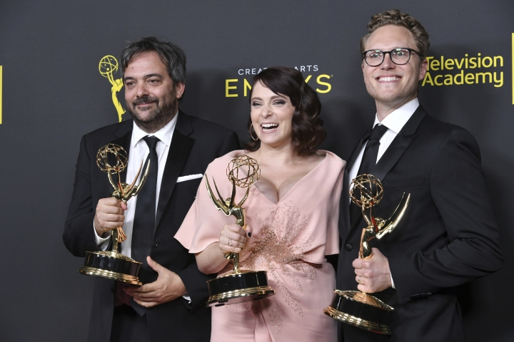 "Adam Schlesinger, from left, Rachel Bloom and Jack Dolgen pose in the press room with their awards for outstanding original music and lyrics for ""Crazy Ex Girlfriend"" on night one of the Creative Arts Emmy Awards on Saturday, Sept. 14, 2019, at the Microsoft Theater in Los Angeles. (Photo by Richard Shotwell/Invision/AP)"