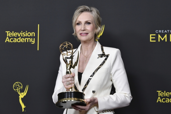 "CORRECTS THE DATE TO SUNDAY, SEPT. 15 - Jane Lynch poses in the press room with the award for outstanding guest actress in a comedy series for ""The Marvelous Mrs. Maisel"" on night two of the Creative Arts Emmy Awards on Sunday, Sept. 15, 2019, at the Microsoft Theater in Los Angeles. (Photo by Richard Shotwell/Invision/AP)"