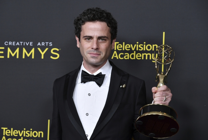"Luke Kirby poses in the press room with the award for outstanding guest actor in a comedy series for ""The Marvelous Mrs. Maisel"" on night two of the Creative Arts Emmy Awards on Sunday, Sept. 15, 2019, at the Microsoft Theater in Los Angeles. (Photo by Richard Shotwell/Invision/AP)"
