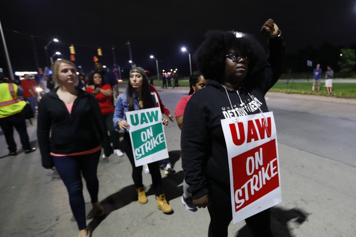 United Auto Workers members picket outside the General Motors Detroit-Hamtramck assembly plant in Hamtramck, Mich., early Monday, Sept. 16, 2019. Roughly 49,000 workers at General Motors plants in the U.S. planned to strike just before midnight Sunday, but talks between the UAW and the automaker will resume. (AP Photo/Paul Sancya)