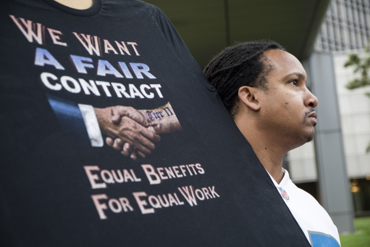 Sean Crawford, of United Auto Workers 598, rallies outside the Marriott Renaissance Hotel while the UAW GM Council holds a meeting inside the hotel in Detroit, Sunday Sept. 15, 2019. The United Auto Workers union announced that tens of thousands of its members at General Motors plants in the U.S. will go on strike Sunday night because contract negotiations with the automaker had broken down. (Kathleen Galligan/Detroit Free Press via AP)