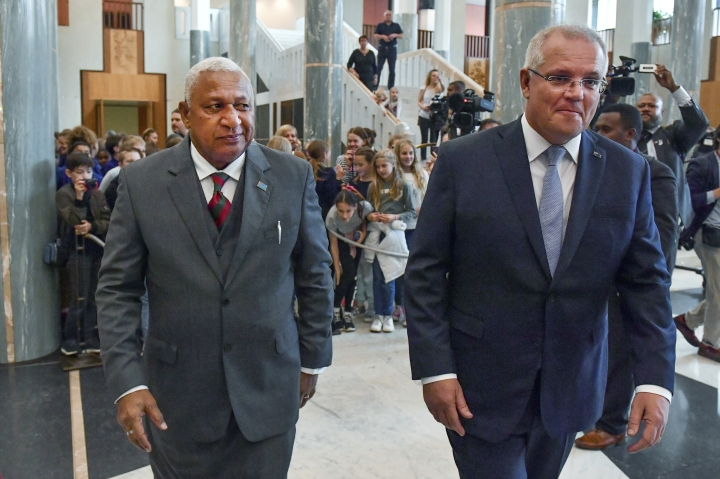 Australia's Prime Minister Scott Morrison, right, and Fiji's Prime Minister Voreqe Bainimarama walk through Parliament House after an official welcome ceremony in Canberra, Monday, Sept. 16, 2019. (Mick Tsikas/Pool via AP)