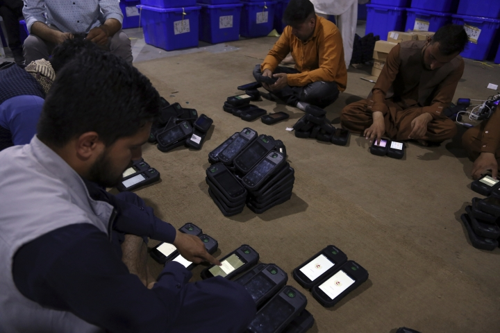 Election commission workers check biometric devices in preparation for the presidential election scheduled for Sept 28, at the Independent Election Commission compound in Kabul, Afghanistan, Sunday, Sept. 15, 2019. Afghan officials say around 100,000 members of the country's security forces are ready for polling day. (AP Photo/Rahmat Gul)
