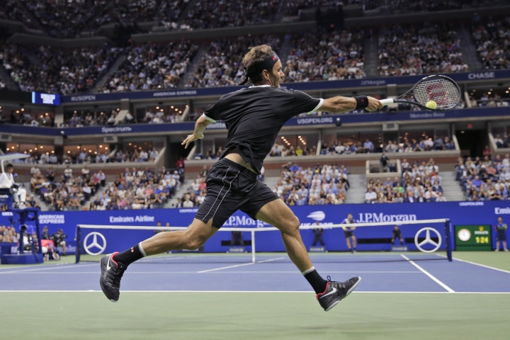 Roger Federer, of Switzerland, runs down a shot from Grigor Dimitrov, of Bulgaria, during the quarterfinals of the U.S. Open tennis tournament Tuesday, Sept. 3, 2019, in New York. (AP Photo/Seth Wenig)