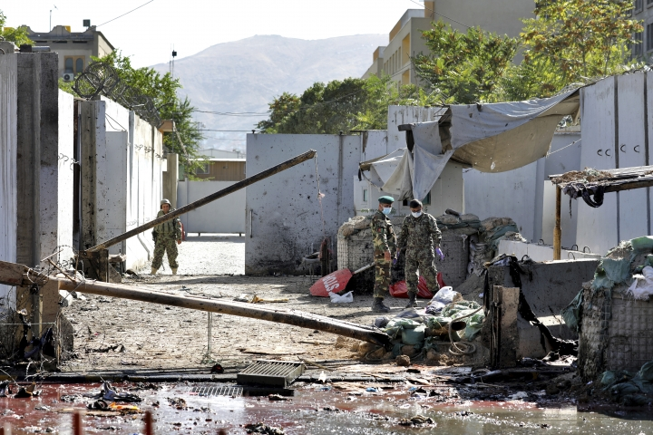 Afghan security forces work at the site of a suicide attack near the U.S. Embassy in Kabul, Afghanistan, Tuesday, Sept. 17, 2019. Hours earlier Afghan officials said a suicide bomber rammed his motorcycle packed with explosives into the entrance to a campaign rally of President Ashraf Ghani in northern Parwan province, killing over 20 people and wounding over 30. Ghani was present at the venue but was unharmed. The Taliban have claimed both attacks. (AP Photo/Ebrahim Noroozi)