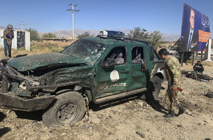 Afghan police inspect the site of a suicide attack, in Parwan province of Afghanistan, Tuesday, Sept. 17, 2019. The Taliban suicide bomber on a motorcycle targeted a campaign rally by President Ashraf Ghani in northern Afghanistan on Tuesday, killing over 20 people and wounding over 30. Ghani was present at the venue but was unharmed, according to his campaign chief. (AP Photo/Rahmat Gul)