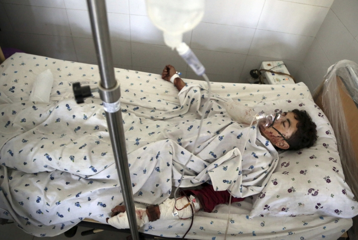 A wounded man receives treatment at a hospital after a suicide attack in northern Parwan province, Afghanistan, Tuesday, Sept. 17, 2019. The Taliban suicide bomber on a motorcycle targeted presidential guards who were protecting President Ashraf Ghani at a campaign rally in northern Afghanistan on Tuesday, killing over 20 people and wounding over 30. Ghani was present at the venue but was unharmed, according to his campaign chief. (AP Photo/Rahmat Gul)