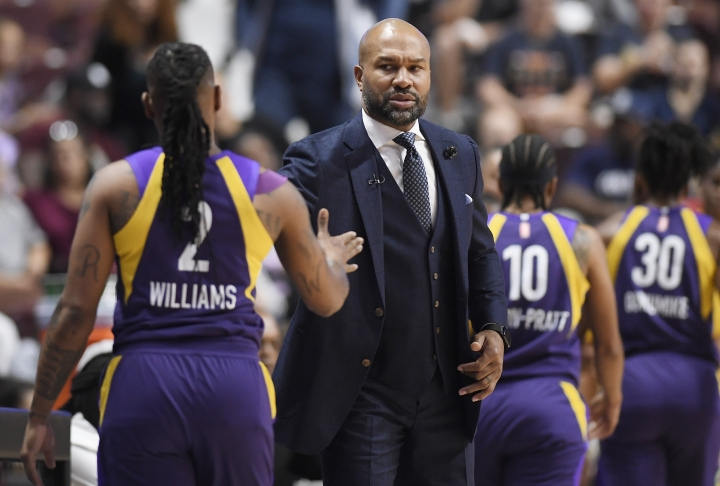 Los Angeles Sparks head coach Derek Fisher greets Los Angeles Sparks' Riquna Williams (2) as she comes out of the game during the first half of Game 1 of a WNBA basketball playoff game, Tuesday, Sept. 17, 2019, in Uncasville, Conn. (AP Photo/Jessica Hill)