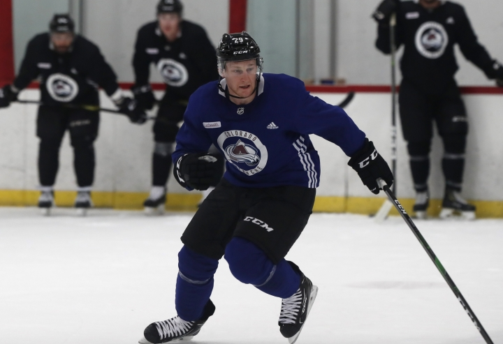 FILE - In this Friday, Sept. 13, 2019, file photo, Colorado Avalanche center Nathan MacKinnon takes part in a drill in the opening session of the team's NHL hockey training camp in Englewood, Colo. Already considered one of the fastest hockey players on earth, MacKinnon carried the Colorado Avalanche to within one victory of the Western Conference final and is the biggest reason they're a fashionable Cup contender this season. (AP Photo/David Zalubowski, File)