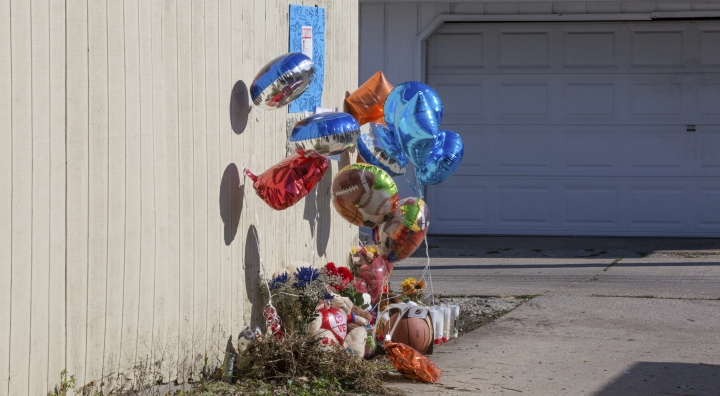 "FILE - In this Nov. 4, 2015 file photo a makeshift memorial sits where Tyshawn Lee was fatally shot in Chicago. The trial of two men charged with first-degree murder in the 2015 slaying of the 9-year-old Chicago boy got underway Tuesday, Sept. 17, 2019, with a prosecutor noting the victim brought a basketball to a park while his alleged killers ""brought guns."" (AP Photo/Teresa Crawford File)"