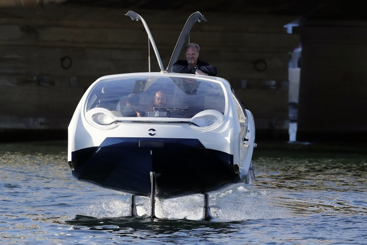 SeaBubbles co-founder Sweden's Anders Bringdal stands onboard a SeaBubble, Wednesday Sept. 18, 2019 in Paris. Paris is testing out a new form of travel - an eco-friendly bubble-shaped taxi that zips along the water, capable of whisking passengers up and down the Seine River. Dubbed Seabubbles, the vehicle is still in early stages, but proponents see it as a new model for the fast-changing landscape of urban mobility. (AP Photo/Francois Mori)