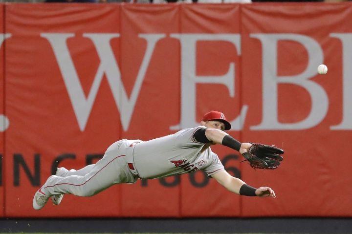 Los Angeles Angels right fielder Kole Calhoun dives to catch a ball hit by New York Yankees' Luke Voit for the out during the second inning of a baseball game Wednesday, Sept. 18, 2019, in New York. (AP Photo/Frank Franklin II)