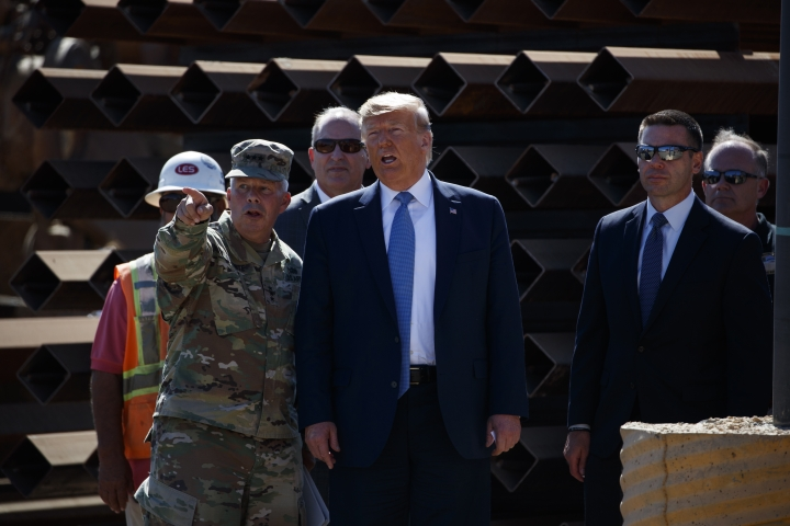 President Donald Trump tours a section of the southern border wall, Wednesday, Sept. 18, 2019, in Otay Mesa, Calif., with the Commanding General of the Army Corps of Engineers Lt. Gen. Todd Semonite, left, acting commissioner of Customs and Border Protection Mark Morgan, center left, and acting Homeland Secretary Kevin McAleenan. (AP Photo/Evan Vucci)