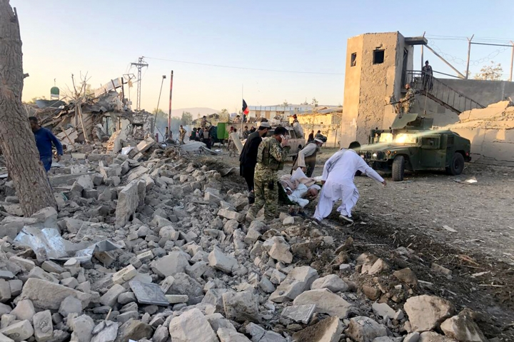 Afghan security members and people work at the site of a suicide attack in Zabul, Afghanistan, Thursday, Sept. 19, 2019. A powerful early morning suicide truck bomb devastated a hospital in southern Afghanistan on Thursday. (AP Photo/Ahmad Wali Sarhadi)