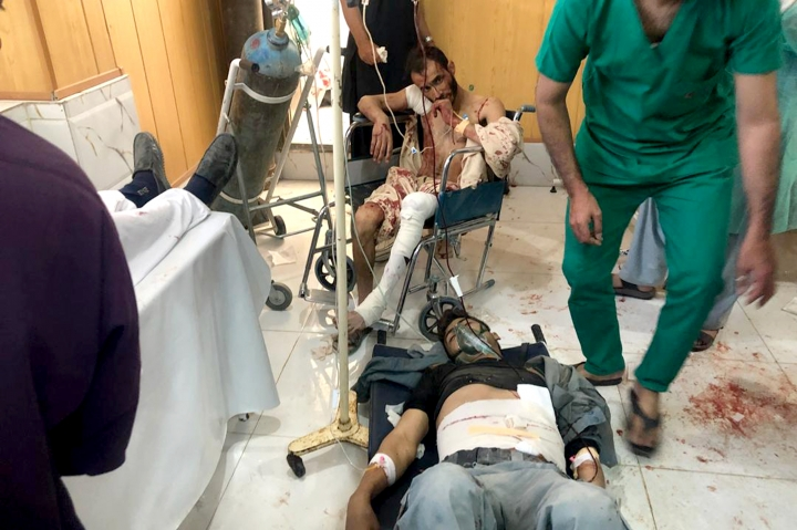 Injured men receive treatment at a hospital after a suicide attack in Zabul, Afghanistan, Thursday, Sept. 19, 2019. A powerful early morning suicide truck bomb devastated a hospital in southern Afghanistan on Thursday. (AP Photo/Ahmad Wali Sarhadi)