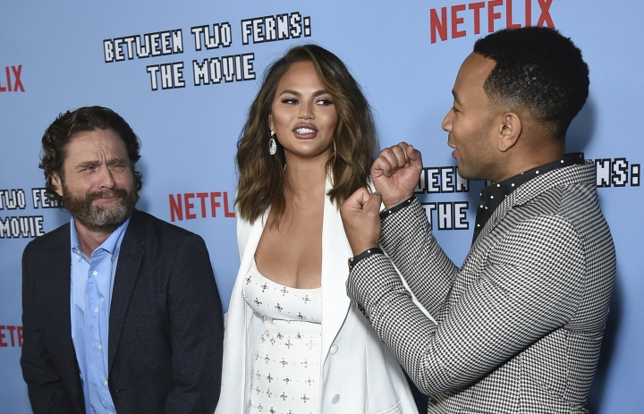 "Zach Galifianakis, from left, Chrissy Teigen and John Legend arrive at the Los Angeles premiere of ""Between Two Ferns: The Movie"" at ArcLight Hollywood on Monday, Sept. 16, 2019. (Photo by Jordan Strauss/Invision/AP)"