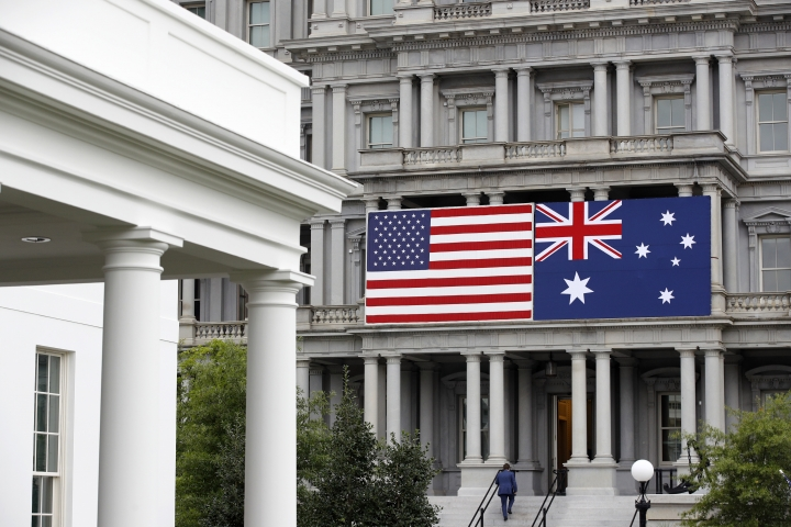 An American and Australian flag hang from the Eisenhower Executive Office Building on the grounds of the White House Complex in Washington, Tuesday, Sept. 17, 2019, ahead of Australian Prime Minister Scott Morrison's state visit. President Donald Trump is scheduled to welcome Morrison to the White House Friday, Sept. 20. (AP Photo/Patrick Semansky)