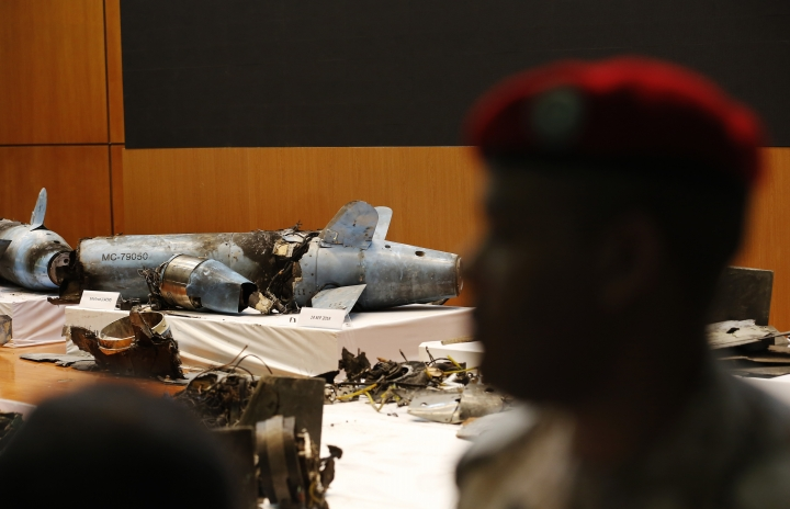 A Saudi military officer stands near what was described as an Iranian cruise missile used in an attack this weekend that targeted the heart of Saudi Arabia's oil industry, during a press conference, in Riyadh, Saudi Arabia, Wednesday, Sept. 18, 2019. Though Yemen's Houthi rebels claimed the assault, the U.S. alleges Iran was behind it. (AP Photo/Amr Nabil)