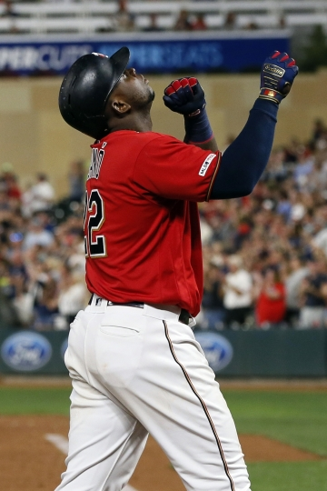 Minnesota Twins' Miguel Sano celebrates his solo home run off Kansas City Royals pitcher Mike Montgomery during the third inning of a baseball game Thursday, Sept. 19, 2019, in Minneapolis. (AP Photo/Jim Mone)