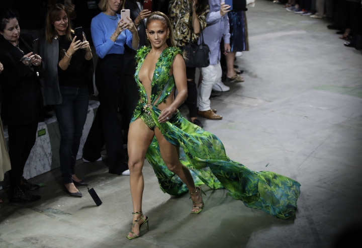 Actress Jennifer Lopez wears a creation as part of the Versace Spring-Summer 2020 collection, unveiled during the fashion week, in Milan, Italy, Friday, Sept. 20, 2019. (AP Photo/Luca Bruno)