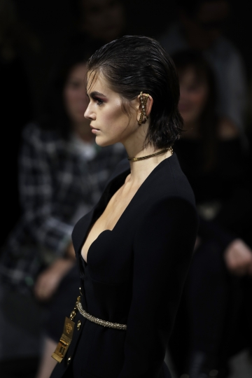 Model Kaia Gerber wears a creation as part of the Versace Spring-Summer 2020 collection, unveiled during the fashion week, in Milan, Italy, Friday, Sept. 20, 2019. (AP Photo/Luca Bruno)