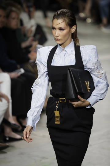 Model Bella Hadid wears a creation as part of the Versace Spring-Summer 2020 collection, unveiled during the fashion week, in Milan, Italy, Friday, Sept. 20, 2019. (AP Photo/Luca Bruno)