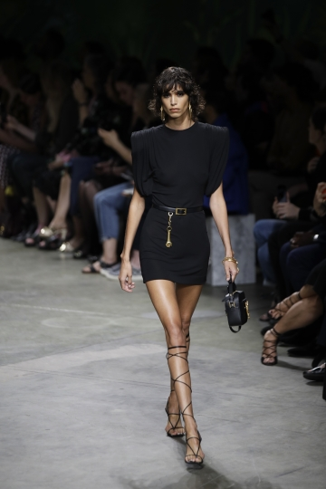 A model wears a creation as part of the Versace Spring-Summer 2020 collection, unveiled during the fashion week, in Milan, Italy, Friday, Sept. 20, 2019. (AP Photo/Luca Bruno)