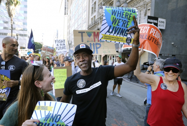 Actor Don Cheadle marches with a group of protestors during a global climate rally along the streets of downtown Los Angeles on Friday, Sept. 20, 2019. A wave of climate change protests swept across the globe Friday, with hundreds of thousands of young people sending a message to leaders headed for a U.N. summit: The warming world can't wait for action. (AP Photo/David Swanson)