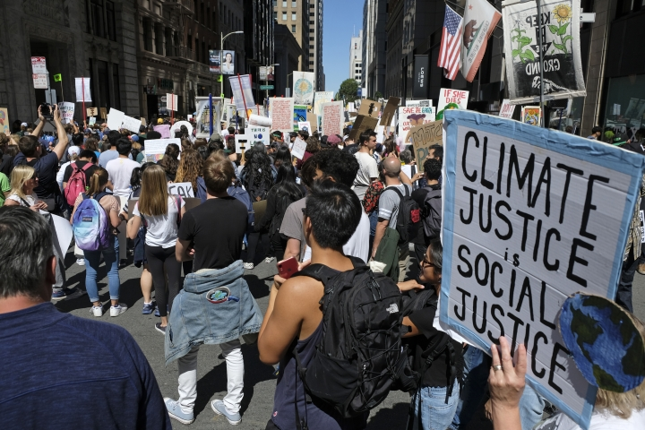 People march through the Financial District during a climate strike protest, Friday, Sept. 20, 2019, in San Francisco. A wave of climate change protests swept across the globe Friday, with hundreds of thousands of young people sending a message to leaders headed for a U.N. summit: The warming world can't wait for action. (AP Photo/Eric Risberg)