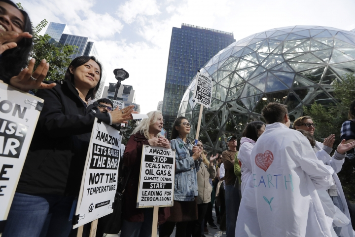 """Amazon employees and supporters gather for a rally at the company's headquarters during a climate strike Friday, Sept. 20, 2019, in Seattle. Across the globe, hundreds of thousands of people took the streets Friday to demand that leaders tackle climate change in the run-up to a U.N. summit. Many were children who skipped school to take part in the second """"Global Climate Strike,"""" following a similar event in March that drew large crowds. (AP Photo/Elaine Thompson)"""