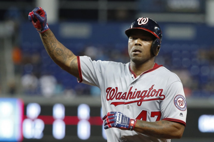 Washington Nationals' Howie Kendrick celebrates a base hit during the sixth inning of a baseball game against the Miami Marlins, Friday, Sept. 20, 2019, in Miami. (AP Photo/Wilfredo Lee)