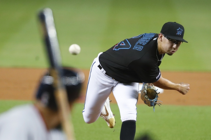 Miami Marlins' Robert Dugger pitches to Washington Nationals' Anthony Rendon during the first inning of a baseball game Friday, Sept. 20, 2019, in Miami. (AP Photo/Wilfredo Lee)