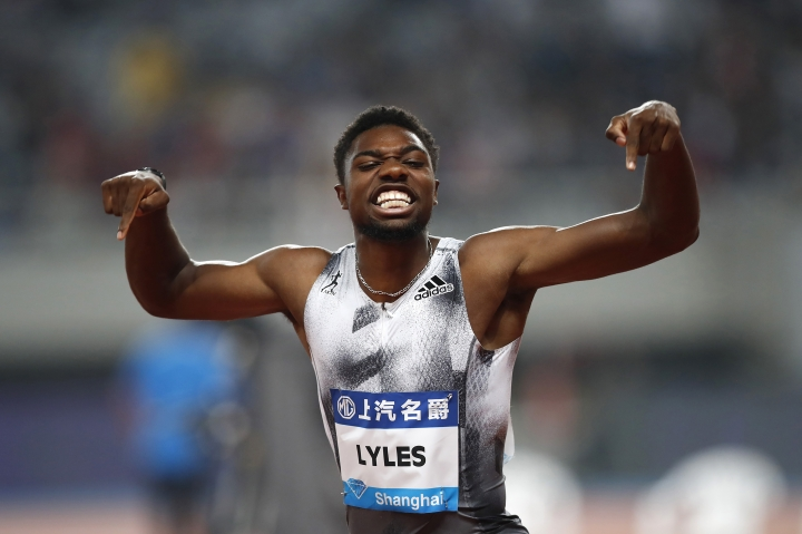 FILE - In this May 18, 2019, file photo, Noah Lyles of the United States reacts after winning the men's 100-meter race during the Diamond League Track and Field meet in Shanghai, China. The most promising signal that track and field remains in good hands even after Usain Bolt's retirement comes from a 22-year-old American named Noah Lyles who appreciates the Jamaican superstar more for what he did after his races than during them. When Lyles spends time studying Bolt on video, he looks not at the lanky speedster's form in between the lines, but at the dancing, rollicking post-race celebrations Bolt concocted to make his sport can't-miss viewing whenever he was on the track. (AP Photo/File)