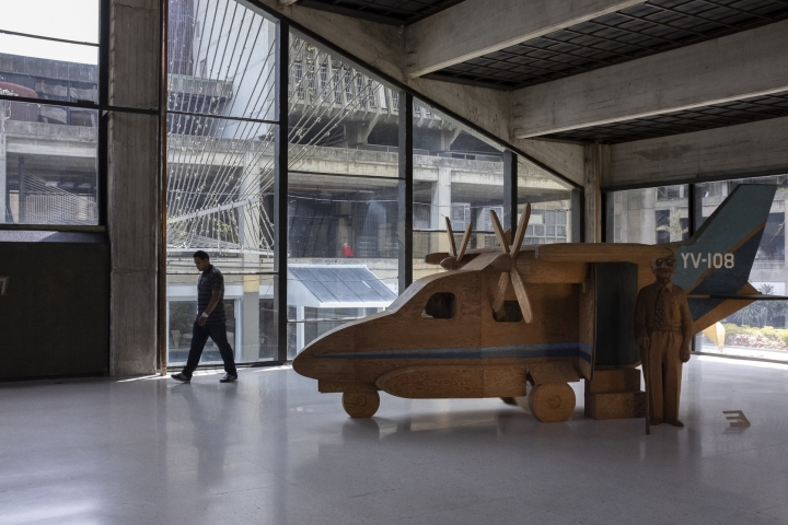 In this Sept. 17, 2019, photo, a man walks in front of Marisol Escobar's sculpture The Airplane in the Museum of Contemporary Art of Caracas, Venezuela. Today, the museum, which boasted the largest collection of contemporary art in Latin America when it was founded in the 1970s, is a shadow of its former glory. (AP Photo/Andrea Hernandez Briceño)