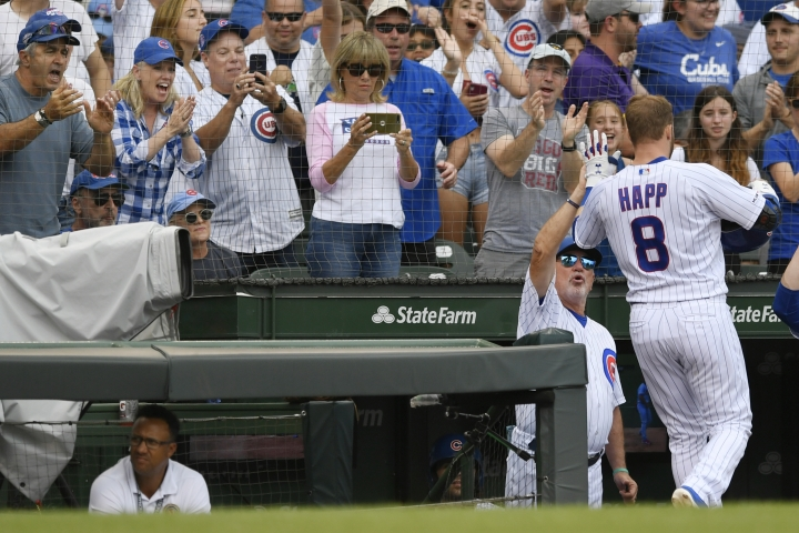Chicago Cubs' Ian Happ (8) celebrates with manager Joe Maddon at the dugout after hitting a two-run home run during the fourth inning of baseball game against the St. Louis Cardinals Saturday, Sept. 21, 2019, in Chicago. (AP Photo/Paul Beaty)
