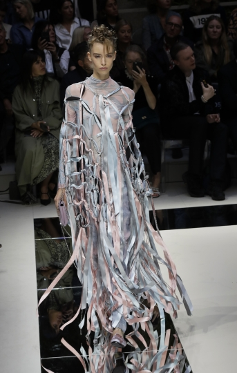 EDS NOTE: NUDITY - A model wears a creation as part of the Armani Spring-Summer 2020 collection, unveiled during the fashion week, in Milan, Italy, Saturday, Sept. 21, 2019. (AP Photo/Luca Bruno)