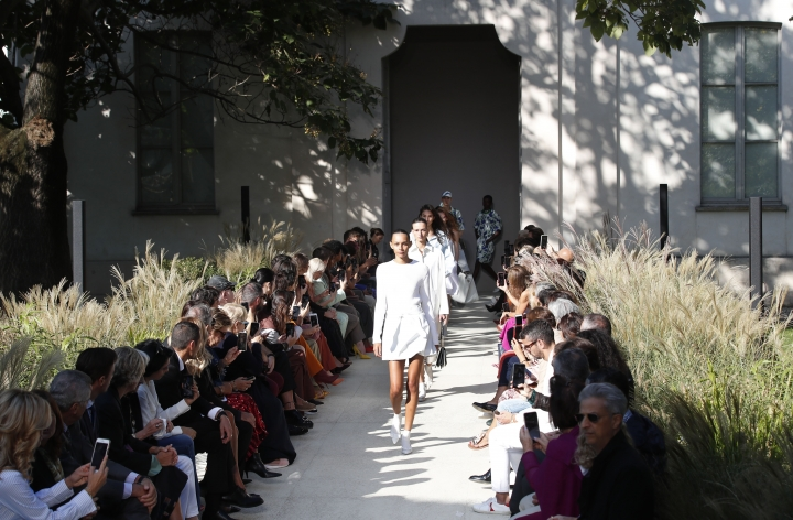 Models wear creations as part of the Salvatore Ferragamo Spring-Summer 2020 collection, unveiled during the fashion week, in Milan, Italy, Saturday, Sept. 21, 2019. (AP Photo/Antonio Calanni)