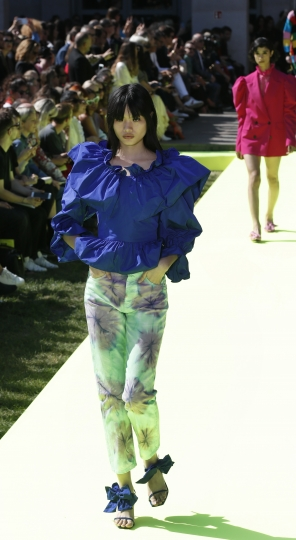 A model wears a creation as part of the MSGM Spring-Summer 2020 collection, unveiled during the fashion week, in Milan, Italy, Saturday, Sept. 21, 2019. (AP Photo/Antonio Calanni)