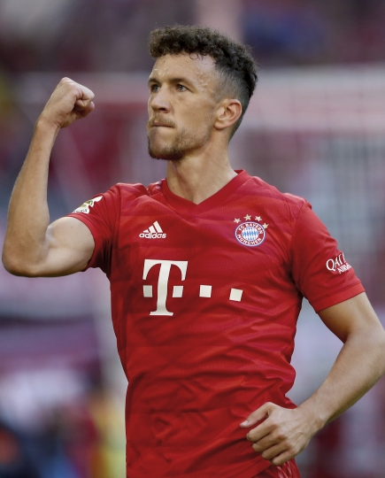 Bayern's Ivan Perisic celebrates after scoring his side's fourth goal during the German Bundesliga soccer match between FC Bayern Munich and 1. FC Cologne in Munich, Germany, Saturday, Sept. 21, 2019. (AP Photo/Matthias Schrader)