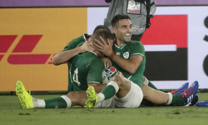 Ireland's Conor Murray, right, congratulates teammate Andrew Conway after he scored their fourth try during the Rugby World Cup Pool A game at International Stadium between Ireland and Scotland in Yokohama, Japan, Sunday, Sept. 22, 2019. (AP Photo/Jae Hong)