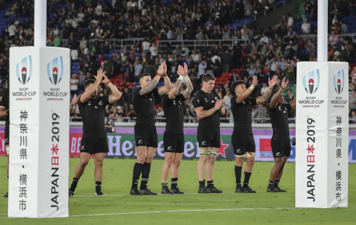 New Zealand's rugby team players clap to the crowd after winning against South Africa during their match at the Rugby World Cup Pool B game in Yokohama, Japan, Saturday, Sept. 21, 2019. (AP Photo/Koji Sasahara)