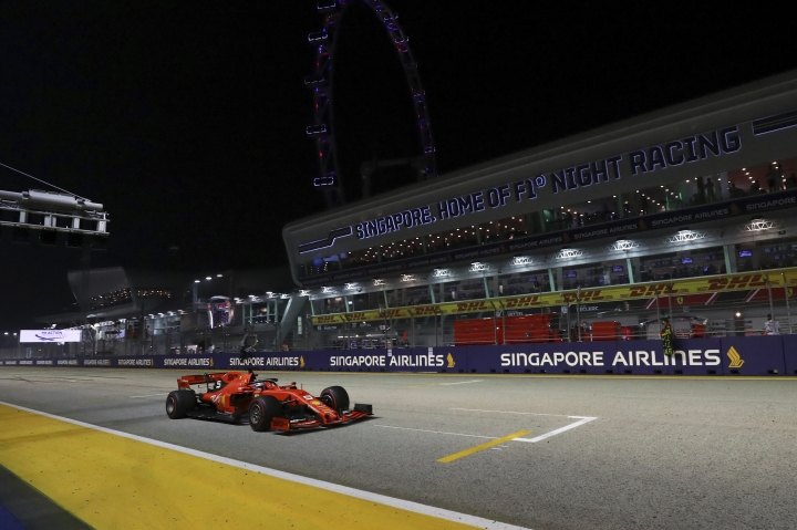 Ferrari driver Sebastian Vettel of Germany steers his car on the way to win the Singapore Formula One Grand Prix, at the Marina Bay City Circuit in Singapore, Sunday, Sept. 22, 2019. (AP Photo/Lim Yong Teck)