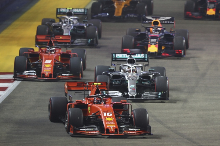 Ferrari driver Charles Leclerc of Monaco leads the field at the start of the Singapore Formula One Grand Prix, at the Marina Bay City Circuit in Singapore, Sunday, Sept. 22, 2019. (AP Photo/Lim Yong Teck)