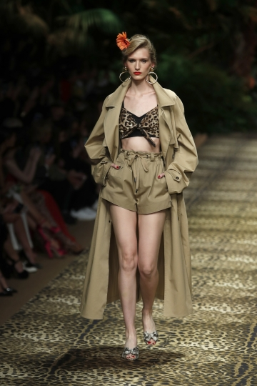 A model wears a creation as part of the Dolce & Gabbana Spring-Summer 2020 collection, unveiled during the fashion week, in Milan, Italy, Sunday, Sept. 22, 2019. (AP Photo/Antonio Calanni)