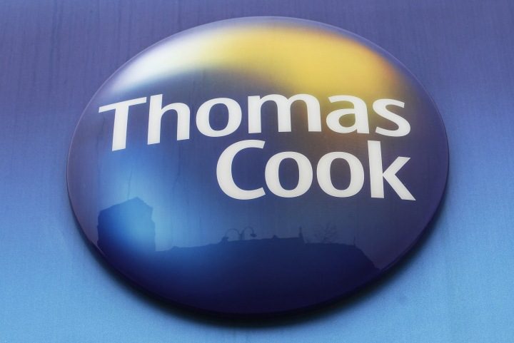 FILE - In this Tuesday, Nov. 22, 2011 file photo, a sign of Thomas Cook travel agent is seen at a branch in north London. More than 600,000 vacationers who booked through tour operator Thomas Cook were on edge Sunday, wondering if they will be able to get home, as one of the world's oldest and biggest travel companies teetered on the edge of collapse. The debt-laden company, which confirmed Friday it was seeking 200 million pounds ($250 million) in funding to avoid going bust, was in talks with shareholders and creditors to stave off failure. (AP Photo/Sang Tan, File)