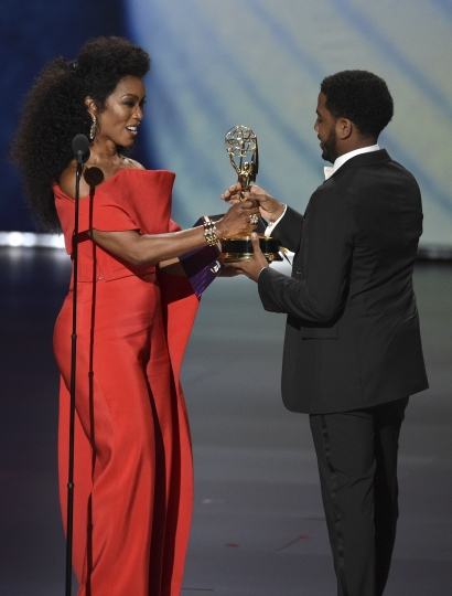 "Angela Bassett , left, presents Jharrel Jerome with the award for outstanding lead actor in a limited series or movie for ""When They See Us""at the 71st Primetime Emmy Awards on Sunday, Sept. 22, 2019, at the Microsoft Theater in Los Angeles. (Photo by Chris Pizzello/Invision/AP)"